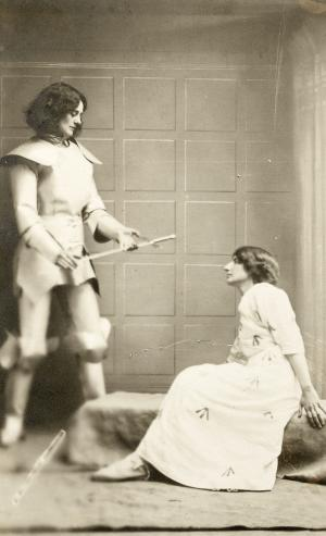 Countess de Markievicz dressed as Joan of Arc presenting a sword to a suffrage prisoner