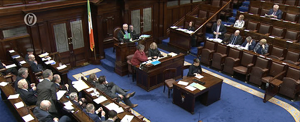 Parliamentary reporter sitting at the centre of the Dáil Chamber