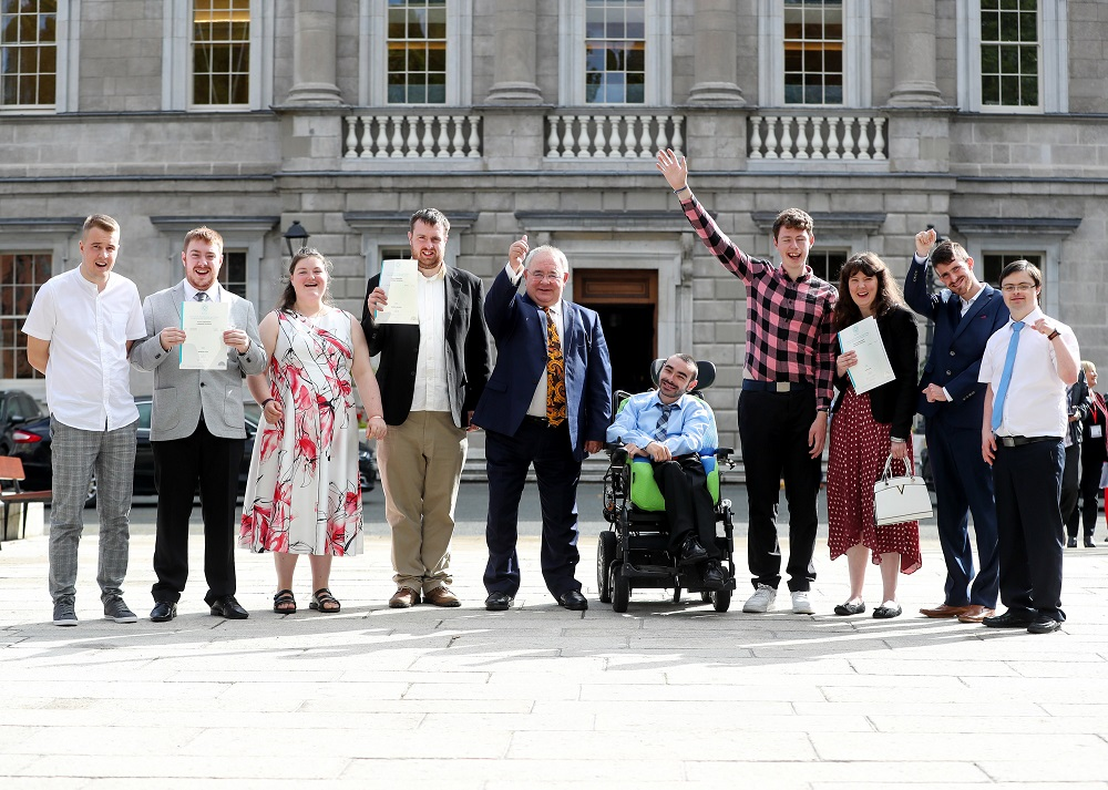 Gradutes of work experience programme for people with intellectual disabilities outside Leinster House with the Ceann Comhairle