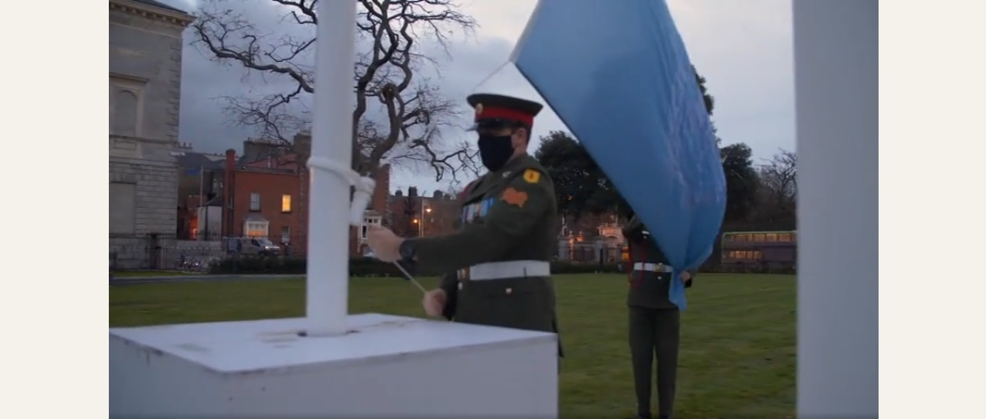 Members of the Defence Forces raising the United Nations flag outside Leinster house